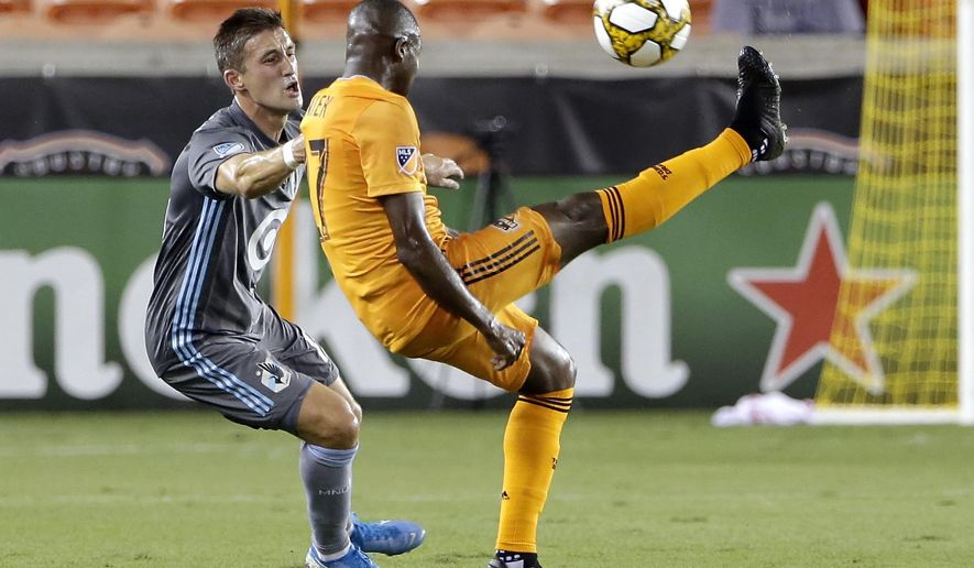 Houston Dynamo midfielder Boniek Garcia, right, brings down the ball in front of Minnesota United midfielder Ethan Finlay during the first half of an MLS soccer match Wednesday, Sept. 11, 2019, in Houston. (AP Photo/Michael Wyke)