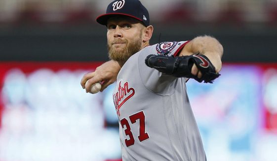 Washington Nationals pitcher Stephen Strasburg throws to a Minnesota Twins batter during the first inning of a baseball game Wednesday, Sept. 11, 2019, in Minneapolis. (AP Photo/Jim Mone) ** FILE **