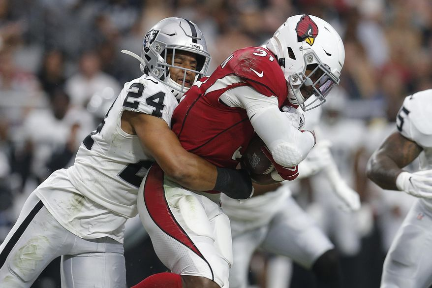 FILE - In this Thursday, Aug. 15, 2019 file photo, Oakland Raiders defensive back Johnathan Abram (24) tackles Arizona Cardinals running back David Johnson (31) during the first half of an an NFL football game in Glendale, Ariz. Oakland Raiders rookie safety Johnathan Abram will be placed on injured reserve after injuring his shoulder in the season opener.Abram injured himself in the first half Monday night, Sept. 9, 2019 against the Denver Broncos. (AP Photo/Ralph Freso, File)