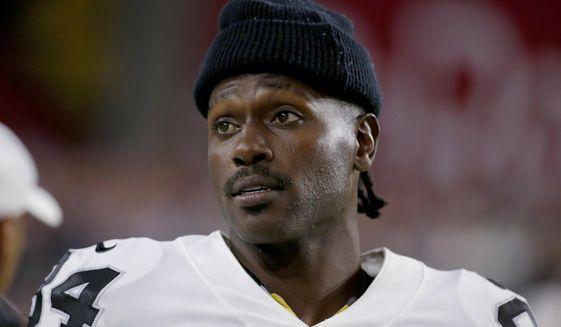In this Aug. 15, 2019, file photo, Oakland Raiders wide receiver Antonio Brown watches from the sidelines during the second half of the team's NFL preseason football game against the Arizona Cardinals in Glendale, Ariz. Brown, who was released by the Raiders last week and is now with the New England Patriots, has been accused of rape by a former trainer. Britney Taylor says Brown sexually assaulted her on three occasions, according to a lawsuit filed Tuesday, Sept. 10, in the Southern District of Florida. Brown has denied the allegations (AP Photo/Rick Scuteri) ** FILE **