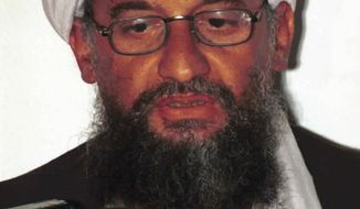 "FILE - In this in this 1998 file photo made available Friday, March 19, 2004, Ayman al-Zawahri speaks to the press in Khost, Afghanistan. On Wednesday, Sept, 11, 2019, Al-Qaeda leader al-Zawahri called on all Muslims to attack U.S., European, Israeli and Russian targets in a speech on the 18th anniversary of the 9/11 terror attacks. SITE Intelligence Group reports that in a video released by the militant group, al-Zawahri  also criticized ""backtrackers"" from jihad. (AP Photo/Mazhar Ali Khan, File)"