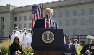 President Donald Trump speaks during a ceremony honoring the victims of the Sept. 11 terrorist attacks, Wednesday, Sept. 11, 2019, at the Pentagon. (AP Photo/Evan Vucci)