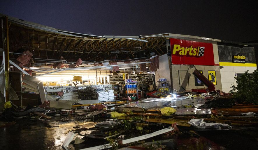 In this Tuesday, Sept. 10, 2019, photo, debris litters the ground at Advance Auto Parts following severe weather in Sioux Falls, S.D. (Abigail Dollins/The Argus Leader via AP)