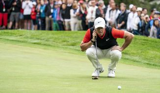 Rory McIlroy of Northern Ireland lines up a putt during the final round the final round of the European Masters golf tournament in Crans-Montana, Switzerland, Sunday, September 1, 2019. (Alexandra Wey/Keystone via AP) **FILE**