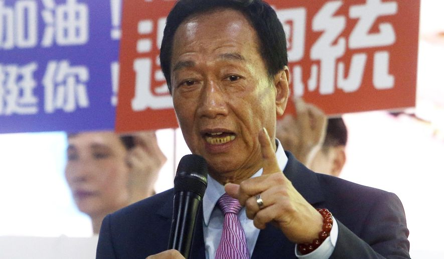 FILE - In this June 21, 2019, file photo, Terry Gou, chairman of Foxconn, the world's largest contract assembler of consumer electronics, speaks to the media after the company's annual shareholders meeting in New Taipei City, Taiwan. Gou, who is considering a run for the presidency, met with former legislative leader Wang Jin-pyng. Gou has until Tuesday to decide. (AP Photo/Chiang Ying-ying, File)