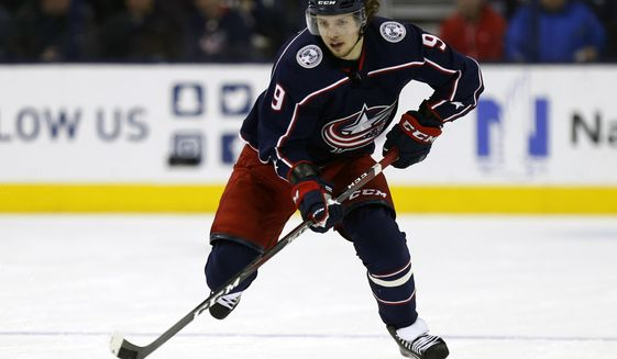 FILE - In this Dec. 11, 2018, file photo, Columbus Blue Jackets forward Artemi Panarin, of Russia, skates with the puck during an NHL hockey game against the Vancouver Canucks in Columbus, Ohio. After the offseason additions of star winger Artemi Panarin and defenseman Jacob Trouba, goaltender Henrik Lundqvist says the New York Rangers have to set their own realistic expectations for themselves this season. That process is one of several things to watch around the NHL when training camps open Thursday. (AP Photo/Paul Vernon, File)