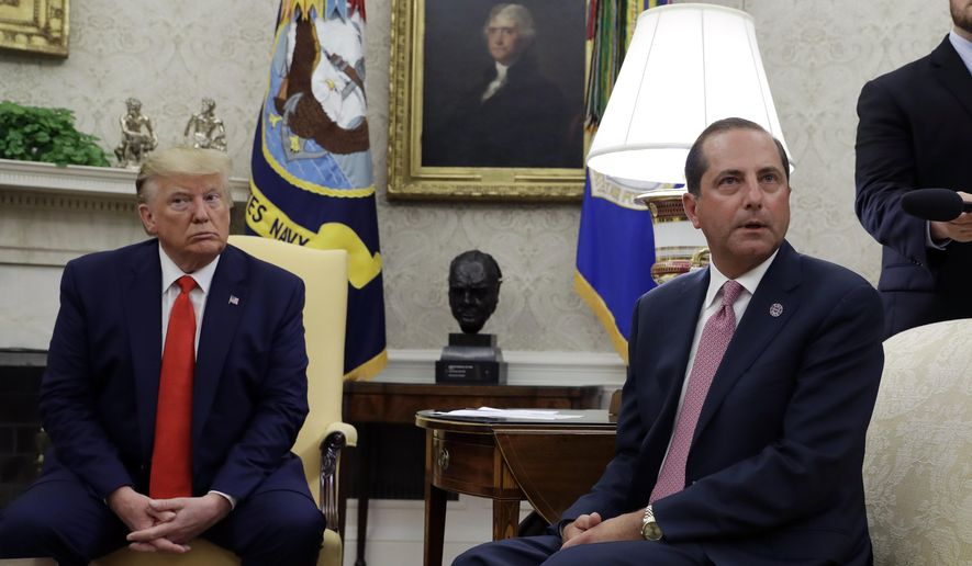 President Donald Trump and Health and Human Services Secretary Alex Azar talk to the media in the Oval Office, Wednesday, Sept. 11, 2019, at the White House in Washington. (AP Photo/Evan Vucci)