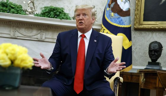 President Donald Trump talks about a plan to ban most flavored e-cigarettes, in the Oval Office of the White House, Wednesday, Sept. 11, 2019, in Washington. (AP Photo/Evan Vucci)