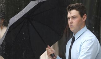 Nathan Daniel Vogel leaves federal court following a hearing Wednesday, Sept. 11, 2019, in Salt Lake City. Vogel, a man who pleaded guilty to lying about buying the firearm used to kill college athlete Lauren McCluskey has been sentenced to three years of supervised release. Vogel said he accepts responsibility for loaning the weapon to McCluskey's ex-boyfriend Melvin Rowland, who killed her last year. (AP Photo/Rick Bowmer)