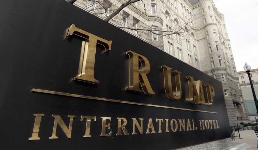 In this Dec. 21, 2016, file photo, The Trump International Hotel at 1100 Pennsylvania Avenue NW, is photographed in Washington. (AP Photo/Alex Brandon) **FILE**
