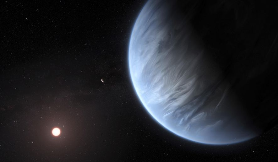 This artist's rendering provided by University College London Centre for Space Exochemistry Data researchers shows exoplanet K2-18b, foreground, its host star and an accompanying planet in this system. On Wednesday, the scientists announced they discovered water on the planet outside our solar system that has temperatures suitable for life. (M. Kornmesser/ESA/Hubble via AP)