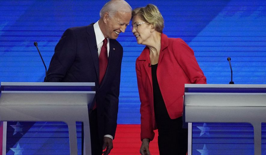 Democratic presidential candidates former Vice President Joe Biden, left and Sen. Elizabeth Warren, D-Mass., talk Thursday, Sept. 12, 2019, during a Democratic presidential primary debate hosted by ABC at Texas Southern University in Houston. (AP Photo/David J. Phillip)