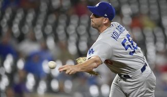 Los Angeles Dodgers relief pitcher Adam Kolarek delivers a pitch during a baseball game against the Baltimore Orioles, Wednesday, Sept. 11, 2019, in Baltimore. The Orioles won 7-3. (AP Photo/Nick Wass) ** FILE **