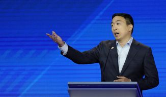 Democratic presidential candidate entrepreneur Andrew Yang gives his closing statement Thursday, Sept. 12, 2019, during a Democratic presidential primary debate hosted by ABC at Texas Southern University in Houston. (AP Photo/David J. Phillip)