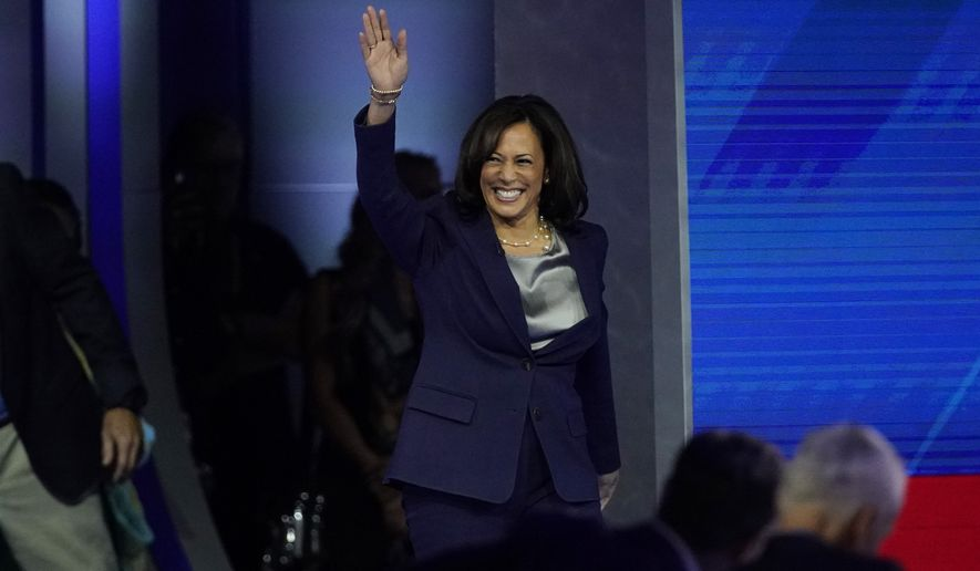 Sen. Kamala Harris, D-Calif., waves as she takes the stage Thursday, Sept. 12, 2019, for a Democratic presidential primary debate hosted by ABC at Texas Southern University in Houston. (AP Photo/David J. Phillip)