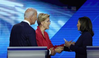 From left, Democratic presidential candidates former Vice President Joe Biden, Sen. Elizabeth Warren, D-Mass., and Sen. Kamala Harris, D-Calif., shake hands Thursday, Sept. 12, 2019, after a Democratic presidential primary debate hosted by ABC at Texas Southern University in Houston. (AP Photo/David J. Phillip)