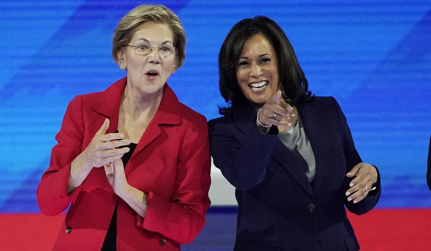 Democratic presidential candidate Sen. Elizabeth Warren, D-Mass., left and Democratic presidential candidate Sen. Kamala Harris, D-Calif. react to the audience Thursday, Sept. 12, 2019, before a Democratic presidential primary debate hosted by ABC at Texas Southern University in Houston. (AP Photo/David J. Phillip)