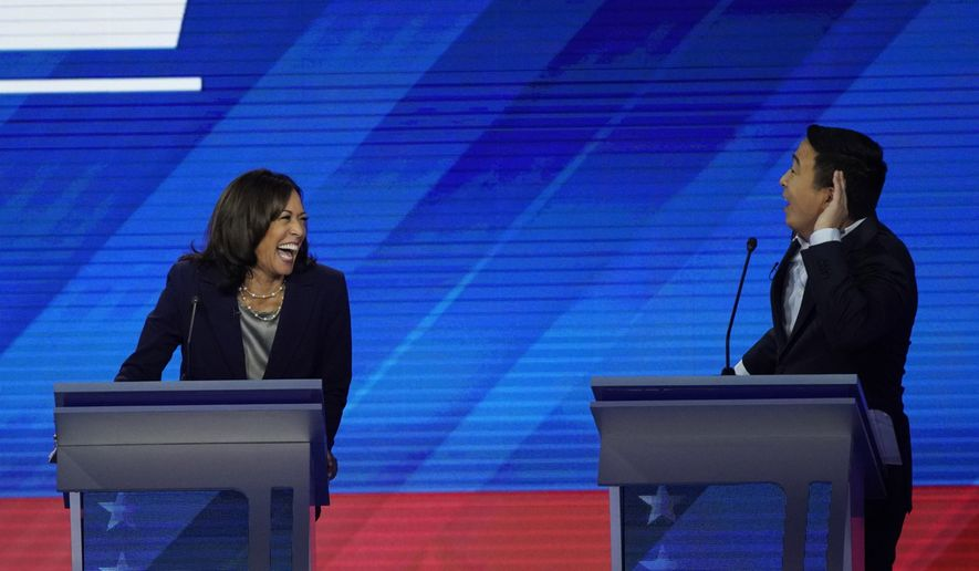 Democratic presidential candidate Sen. Kamala Harris, D-Calif., left, reacts to Democratic presidential candidate entrepreneur Andrew Yang Thursday, Sept. 12, 2019, during a Democratic presidential primary debate hosted by ABC at Texas Southern University in Houston. (AP Photo/David J. Phillip)