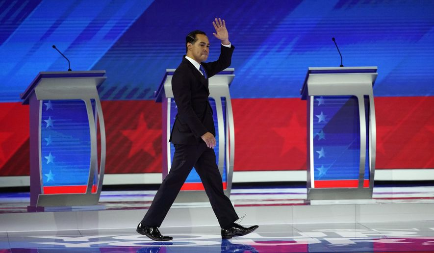 Former Housing and Urban Development Secretary Julian Castro waves as he takes the stage Thursday, Sept. 12, 2019, during a Democratic presidential primary debate hosted by ABC at Texas Southern University in Houston. (AP Photo/David J. Phillip)