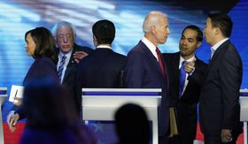 Democratic presidential candidates former Vice President Joe Biden, former Housing and Urban Development Secretary Julian Castro, and Andrew Yang, right, talk Thursday, Sept. 12, 2019, after a Democratic presidential primary debate hosted by ABC at Texas Southern University in Houston, as Sen. Kamala Harris, D-Calif., left, Sen. Bernie Sanders, I-Vt., and South Bend Mayor Pete Buttigieg talk. (AP Photo/David J. Phillip)