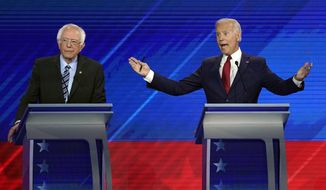 Sen. Bernie Sanders, I-Vt., left, listens as former Vice President Joe Biden, right, speaks Thursday, Sept. 12, 2019, during a Democratic presidential primary debate hosted by ABC at Texas Southern University in Houston. (AP Photo/David J. Phillip)