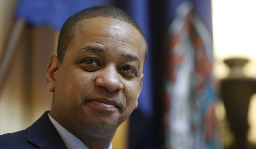 In this Feb. 14, 2019 file photo Virginia Lt. Gov. Justin Fairfax presides over the Senate during the session at the Capitol in Richmond, Va. Fairfax filed a $400 million defamation lawsuit Thursday, Sept. 12 against CBS Corp. and CBS Broadcasting in New York, alleging the network published false statements by two women who have accused him of sexual assault. Virginia Republicans are renewing their call for bipartisan hearings into sexual assault allegations two women have made against Mr. Fairfax. (AP Photo/Steve Helber, File)  **FILE**