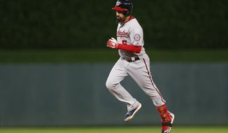 Washington Nationals' Anthony Rendon runs the bases on a solo home run off Minnesota Twins pitcher Kyle Gibson in the first inning of a baseball game Thursday, Sept. 12, 2019, in Minneapolis. (AP Photo/Jim Mone)