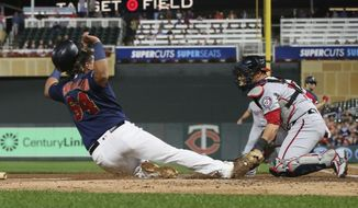 Washington Nationals catcher Yan Gomes, right, tags out Minnesota Twins' Willians Astudillo on a fielder's choice at the plate in the second inning of a baseball game Thursday, Sept. 12, 2019, in Minneapolis. (AP Photo/Jim Mone) ** FILE **