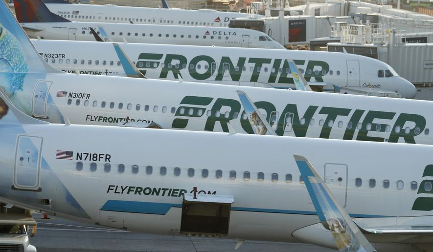 In this June 26, 2019 photo Frontier Airlines jetliners sit at gates on the A concourse at Denver International Airport in Denver. A new report says U.S. airlines are increasing their emissions of climate-changing gases much faster than they are boosting fuel efficiency. The International Council on Clean Transportation said Thursday, Sept. 12, 2019 that carbon dioxide emissions and fuel burning rose 7% from 2016 to 2018, overshadowing a 3% gain in fuel efficiency. The report ranked Frontier the most efficient among the 11 largest U.S. airlines. The Denver-based carrier has added more than 40 Airbus jets with more efficient engines. (AP Photo/David Zalubowski)