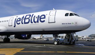 This March 16, 2017, photo shows a Jet Blue airplane at John F. Kennedy International Airport in New York. (AP Photo/Seth Wenig) **FILE**