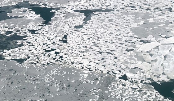 In this Feb. 14, 2019, photo, sheets of ice float in Norton Sound near the Native Village of St. Michael, Alaska, population 400. Transportation in the area is limited to air travel. (AP Photo/Wong Maye-E)