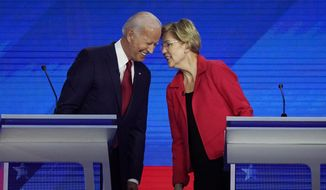 Democratic presidential candidates former Vice President Joe Biden, left and Sen. Elizabeth Warren, D-Mass., talk Thursday, Sept. 12, 2019, during a Democratic presidential primary debate hosted by ABC at Texas Southern University in Houston. (AP Photo/David J. Phillip) ** FILE **