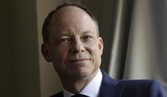 FILE - In this May 15, 2018 file photo, Judge Aaron Persky poses for photos in Los Altos Hills, Calif. Persky, the California judge recalled for his handling of a former Stanford University swimmer's sexual assault case, has been fired from his new job as a high school tennis coach.  (AP Photo/Jeff Chiu, File)