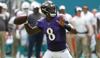 FILE - In this Sept. 8, 2019, file photo, Baltimore Ravens quarterback Lamar Jackson (8) looks to pass the ball during the first half at an NFL football game against the Miami Dolphins, in Miami Gardens, Fla. The Baltimore Ravens are really looking forward to seeing Terrell Suggs this Sunday _ right up until the opening kickoff of their game against the Arizona Cardinals.At the point, the Ravens will turn their attention toward keeping their former teammate clear of quarterback Lamar Jackson.(AP Photo/Wilfredo Lee, File)