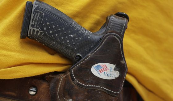 In this April 14, 2018, file photo, a man wears an unloaded pistol during a pro gun-rights rally in Austin, Texas. (AP Photo/Eric Gay, File) **FILE**