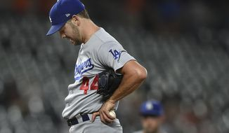 Los Angeles Dodgers pitcher Rich Hill looks down after walking in a run in the first inning of a baseball game against the Baltimore Orioles, Thursday, Sept. 12, 2019, in Baltimore. Hill left the game in the first inning.(AP Photo/Gail Burton)