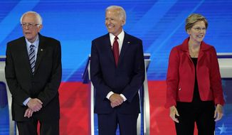 From left, presidential candidates Sen. Bernie Sanders, I-Vt., former Vice President Joe Biden and Sen. Elizabeth Warren, D-Mass., are introduced Thursday, Sept. 12, 2019, before a Democratic presidential primary debate hosted by ABC at Texas Southern University in Houston. (AP Photo/David J. Phillip)