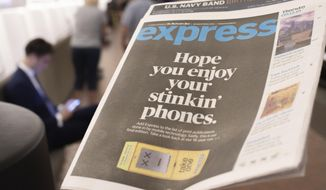 A final copy of the free commuter paper, Express, is seen at McPherson Square Metro Station in downtown Washington, Thursday, Sept. 12, 2019. The Washington Post announced yesterday that it has decided to cease publication of its Express commuter paper, that has been handed out for free at Metro stations for 16 years. (AP Photo/Pablo Martinez Monsivais)