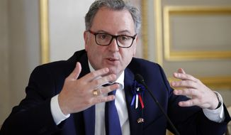 FILE - In this Nov.14, 2018 file photo, French president of the National Assembly Richard Ferrand attends a joint press conference at the National Assembly in Paris. Richard Ferrand, a key ally of French President Emmanuel Macron, said he is determined to continue his job after he was charged with alleged conflict of interest. (AP Photo/Francois Mori, File)