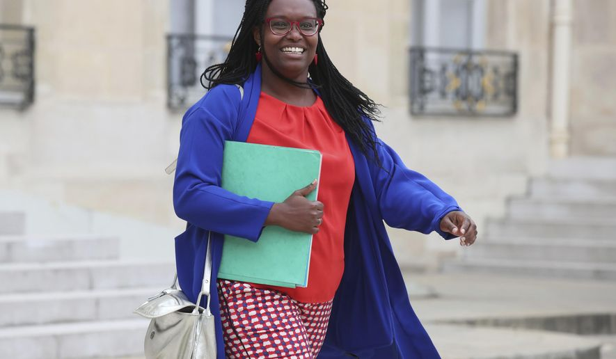 In this photo taken on Wednesday Sept. 4, 2019 French Government's spokesperson Sibeth Ndiaye leaves the cabinet meeting at the Elysee Palace in Paris, France. As Parisians are getting prepared to metro chaos due to a major strike Friday, Sibeth Ndiaye said she will have a thought for struggling passengers from her chauffeur-driven official car. (AP Photo/Michel Euler)