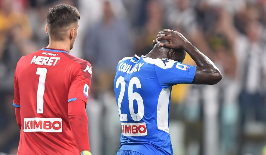 Napoli's Kalidou Koulibaly reacts after scoring the own goal that gave Juventus a 4-3 win, during the Italian Serie A soccer match Juventus and  Napoli at the Allianz Stadium in Turin, Italy, Saturday Aug. 31, 2019. (Alessandro di Marco/ANSA via AP)