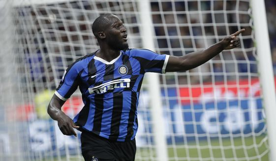 FILE - In this file photo taken on Aug. 26, 2019, Inter Milan's Romelu Lukaku celebrates after scoring his side's third goal during the Serie A soccer match between Inter Milan and Lecce at the San Siro stadium, in Milan, Italy. Lukaku left Manchester United for Inter Milan; of the 79 foreigners who joined Serie A in the recently concluded transfer window, 10 came from the English Premier League _ more than any other league. (AP Photo/Luca Bruno)