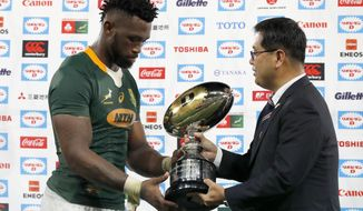 South Africa's Siya Kolisi receives a trophy after a rugby match against Japan at Kumagaya Rugby Stadium Friday, Sept. 6, 2019, in Saitama, Japan. South Africa won 41-7. (AP Photo/Eugene Hoshiko)