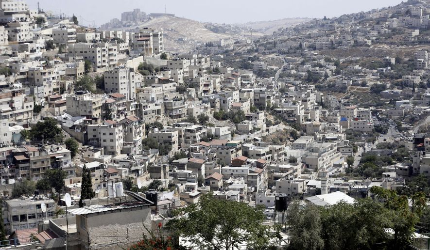 This Monday, Sept. 9, 2019 photo, shows a view of the east Jerusalem neighborhood of Silwan. New official data obtained by The Associated Press shows a spike in Jewish settlement construction in Israeli-annexed east Jerusalem since President Donald Trump took office in 2017, along with strong evidence of decades of systematic discrimination illustrated by a huge gap in the number of construction permits granted to Jewish and Palestinian residents. (AP Photo/Mahmoud Illean)
