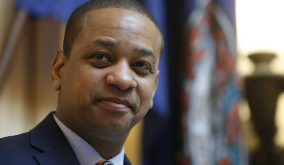 In this Feb. 14, 2019, file photo Virginia Lt. Gov. Justin Fairfax presides over the Senate during the session at the Capitol in Richmond, Va. Fairfax filed a $400 million defamation lawsuit Thursday, Sept. 12 against CBS Corp. and CBS Broadcasting in New York, alleging the network published false statements by two women who have accused him of sexual assault. (AP Photo/Steve Helber, File)
