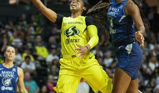 Seattle Storm's Jordin Canada drives past q Minnesota Lynx player during the first half of a WNBA basketball Western Conference semifinal, Wednesday, Sept. 11, 2019, in Everett, Wash. (Dean Rutz/The Seattle Times via AP)