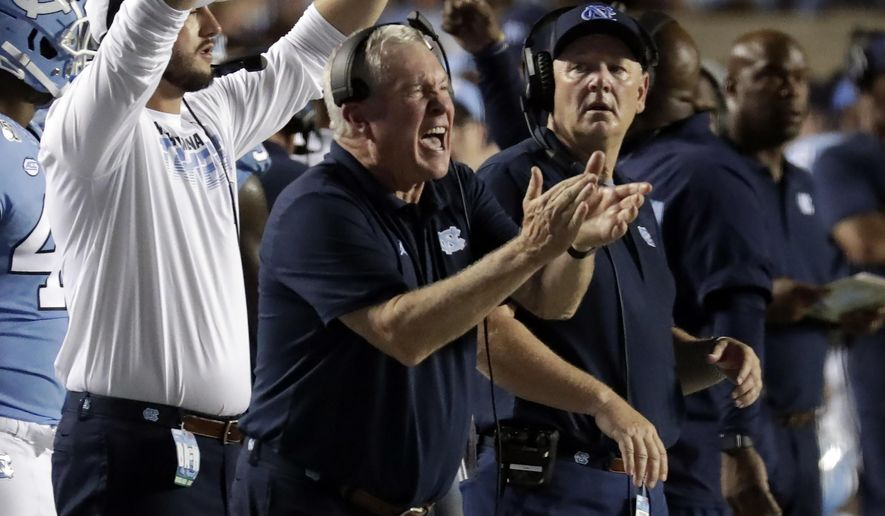 North Carolina coach Mack Brown cheers on his team during the fourth quarter of an NCAA college football game against Miami in Chapel, N.C., Saturday, Sept. 7, 2019. (AP Photo/Chris Seward)