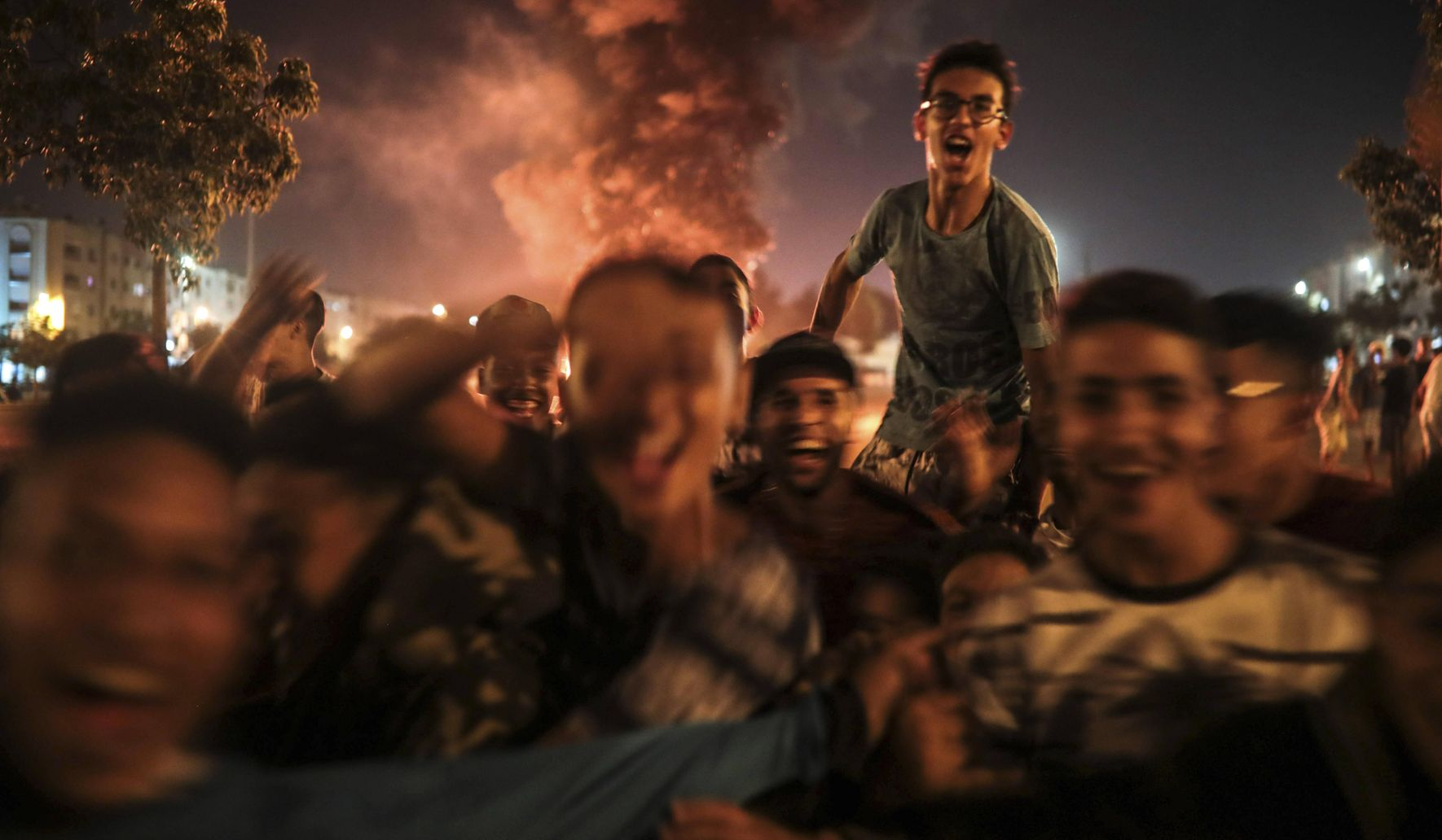 AP PHOTOS: Moroccans feast, light up sky on Shiite holy day