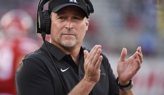 Houston coach Dana Holgorsen applauds during the first half of the team's NCAA college football game against Prairie View on Saturday. Sept. 7, 2019, in Houston. (AP Photo/Eric Christian Smith)