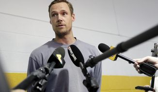 Nashville Predators goaltender Pekka Rinne, of Finland, answers questions as players report to NHL hockey training camp Thursday, Sept. 12, 2019, in Nashville, Tenn. (AP Photo/Mark Humphrey)